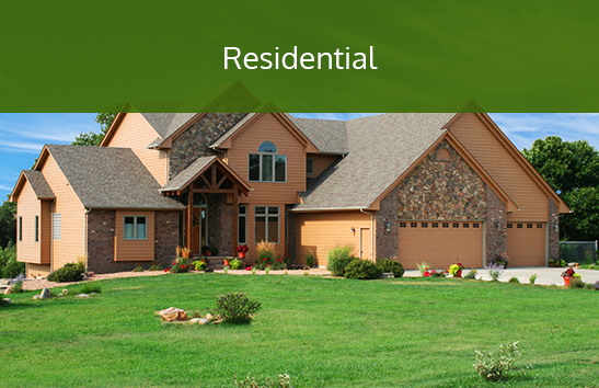 A home with a pristine lawn. Click to learn more about residential services.